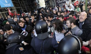 Policemen clash with demonstrators during a general strike on November 14, 2012 in Madrid.
