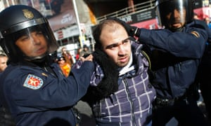 Police detain a man as picketers and protesters clashed with police during a 24-hour nationwide general strike in Madrid, November 14, 2012.