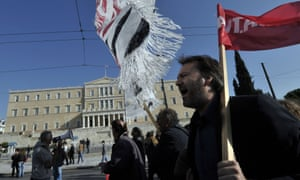 Protesters chant slogans during an anti-austerity protest outside the Greek parliament in Athens on November 14, 2012.