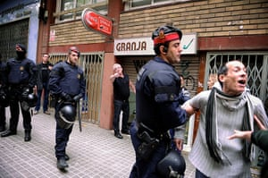 Euro protests: Barcelona, Spain: Riot police protect a restaurant owner