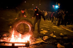 Euro protests: Barcelona, Spain:  Demonstrators set up a barricade of burning tyres
