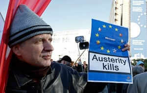 Euro protests: Brussel, Belgium: A protester holds a sign during a march