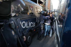Euro protests: Madrid, Spain: Riot police arrest a protestor during a general strike