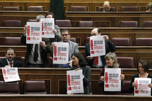 Euro protests: Madrid, Spain: 7Socialist party PSOE's parliamentarians hold posters