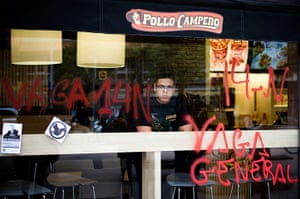 Euro protests: Barcelona, Spain: An employee of restaurant looks through  window