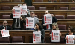 Main opposition Socialist party PSOE's parliamentarians hold posters supporting the general strike during a plenary session at the Lower Chamber in the Spanish Parliament, in Madrid, Spain, 14 November 2012