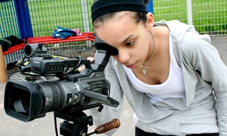 A young woman with a video camera