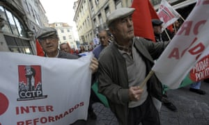 Protesters take part in a demonstration during a general strike in Lisbon on November 14, 2012.