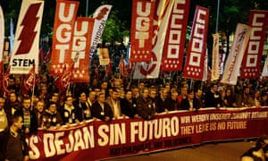 Protesters hold a giant banner in Madrid on November 14 2012.