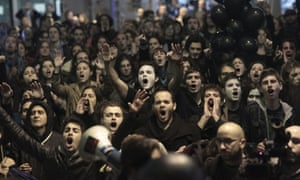 People participate in a demonstration in Madrid on the occasion of the general strike called by trade unions CCOO, UGT and USO against government austerity measures, in Madrid, central Spain, 14 November 2012.