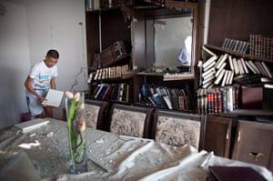 Gaza and Israeli strikes: Kiryat Malachi, Israel: An Israeli youth gathers holy Jewish books