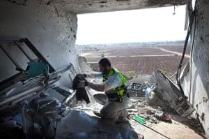 Gaza and Israeli strikes: Kiryat Malachi, Israel: An Israeli emergency serviceman clears an apartment