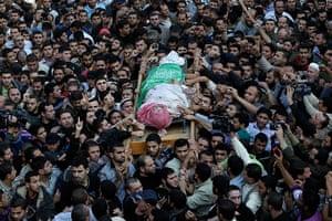 Gaza and Israeli strikes: Gaza City: Palestinian Hamas members carry the body of Ahmed al-Jabari