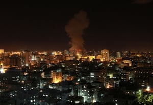 Gaza and Israeli strikes: Gaza City: Smoke rises following an Israeli air strike on a house