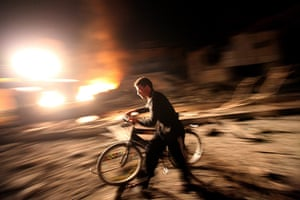 Gaza and Israeli strikes: Gaza City: A Palestinian passes by a destroyed Hamas site