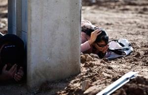 Gaza and Israeli strikes: Kiryat Malachi, Israel: Israelis take cover as a siren sounds