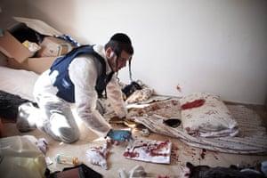 Gaza and Israeli strikes: Kiryat Malachi, Israel: A Zaka volunteer cleans blood stains