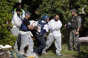 Gaza and Israeli strikes: Sderot, Israel: Rescue workers evacuate victims bodies