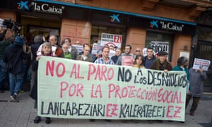 """Protesters hold a banner reading """"No to Unemployment. No to Evictions. For Social Protection"""" at a protest in Barakaldo today. Photograph: Reuters/Vincent West ("""