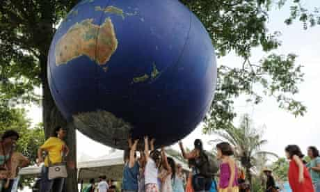 Children play with a giant globe at the