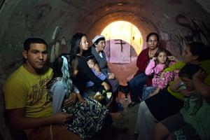 Strikes update: Israel: Israelis sit inside a sewage pipe used as shelter during alert