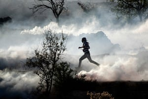 Strikes update: Gaza Strip: A Palestinian demonstrator runs through a cloud of tear gas
