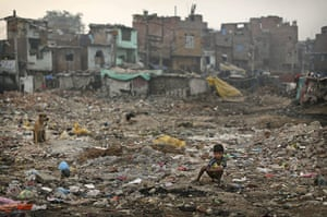 World Toilet Day: An Indian boy defecates in the open, New Delhi, India