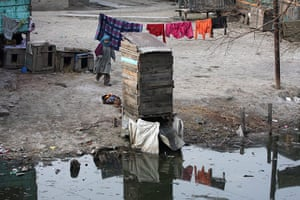 World Toilet Day: A makeshift toilet is erected by the side of a stream in Srinagar