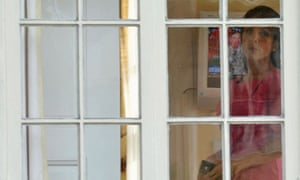 Jill Kelley looks out the window of her home