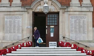 A woman leaves a polling station in Henley-on-Thames