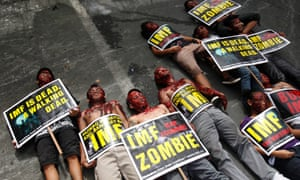 Filipino protesters dressed up as zombies lay on the ground in a rally during the visit of International Monetary Fund (IMF) Managing Director Christine Lagarde near the Malacanang presidential palace in Manila, Philippines, 16 November 2012.