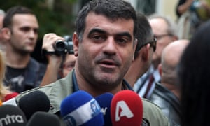 In this Monday, Oct. 29, 2012 photo journalist and magazine publisher Costas Vaxevanis makes statements outside a court in Athens.