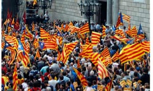 People gather at Sant Jaume Square during a pro-independence rally in Barcelona