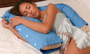person snuggling up with a boyfriend pillow