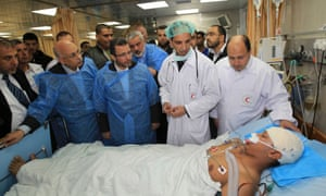 Ismail Haniyeh and Egypt's Prime Minister Hisham Kandil their visit to a hospital in Gaza City