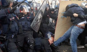 An Italian riot police is kicked into his face by a protester as police and demonstrators were scuffling during a rally of students in Palermo, Sicily, Italy, 16 November 2012.