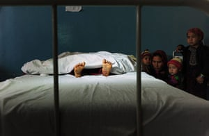20 Photos: The family of a five year old Afghan girl wait by her hospital bed