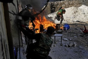 20 Photos: In Aleppo, Syrian rebels of the Halab al-Shabah battalion take position