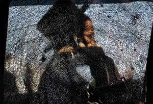 20 Photos: Ultra-Orthodox Jewish man through a damaged car window in Ashdod