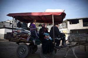 Gaza conflict: A Palestinian family fleeing airstrikes move to a safer area of Gaza City
