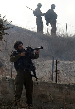Gaza conflict: Israeli soldiers take position during clashes with Palestinians