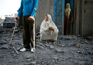 Gaza conflict: Locals look at  destruction after an Israeli air strike on nearby houses