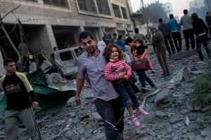 Gaza conflict: Palestinians flee their homes after an Israeli strike  in Gaza City, Monday