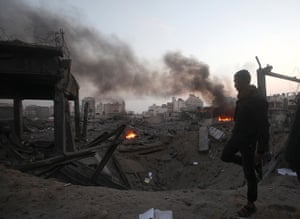 Gaza conflict: A man walks past the remains of a Hamas building n Gaza City