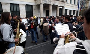 The musical band of the municipality of Athens plays during a protest of municipal workers in front of the building of the municipality in central Athens, Greece, 19 November 2012.
