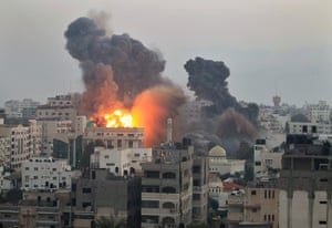 Gaza conflict: Smoke and fire from an Israeli bomb rises into the air ove Gaza City