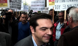 Alexis Tsipras, leader of the radical left main opposition party SYRIZA walks among protesting tourist guides in Athens, Greece, 19 November 2012.