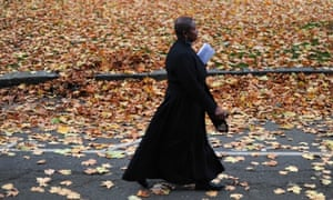 A Church of England vicar, Rose Hudson-Wilkin, walks to the venue of the three-day Church of England General Synod in central London on November 19, 2012, during which their will be a vote on whether to allow women to become bishops.