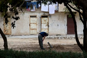 gaza conflict continues: An Israeli police officer inspects an unexploded Grad missile in Ashkelon