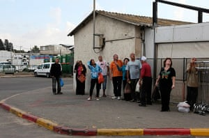 gaza conflict continues: Israelis look up as a siren signals warns of incoming rockets in Ashkelon